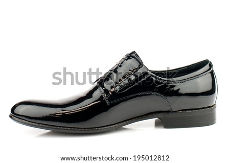 Black man patent leather shoe  with shoelaces on white background. - stock photo