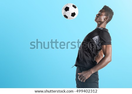 Black man playing football on blue background