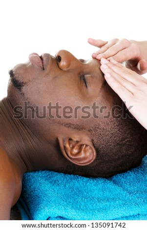 Black man recaiving head massage at spa, isolated on white - stock photo