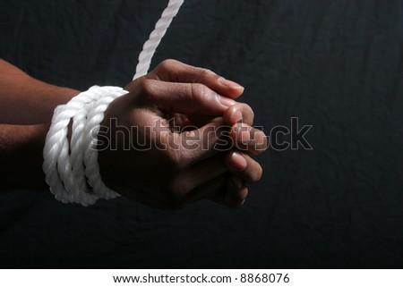 Black Man's hands tied - stock photo