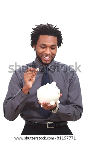 Black man with a piggy bank - stock photo