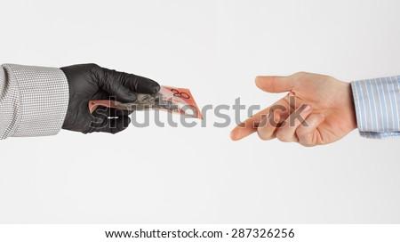 Black market money exchanges hands - stock photo