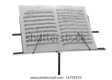 Black metal support with a music book, isolated - stock photo
