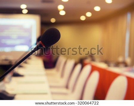 Black microphone in concert hall or conference room with defocused bokeh lights in background. Extremely shallow dof. : Vintage style and filtered process - stock photo