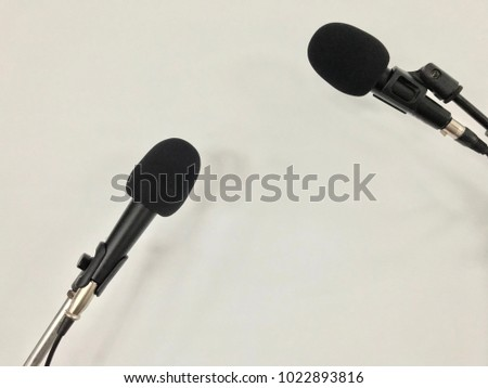 Black microphone on white background for singer, sound recording  equipment