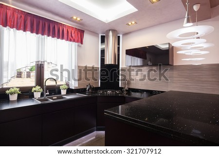 Black modern kitchen in the modern house  - stock photo