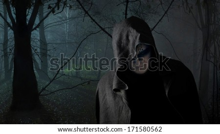 Black monk in the dark forest.