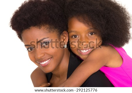 Black mother daughter posing happily looking upwards smiling - stock photo