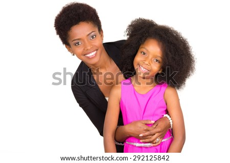 Black mother daughter posing happily with mom behind daughter holding arms around and both facing camera smiling - stock photo