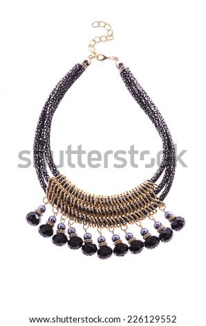 black necklace with beads on white background - stock photo