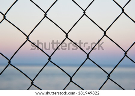 Black net and the sea at the background - stock photo