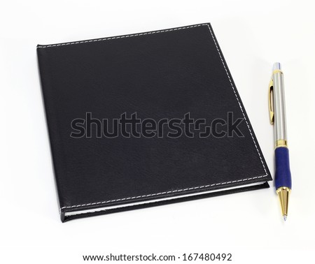 Black note book and pen on white background - stock photo