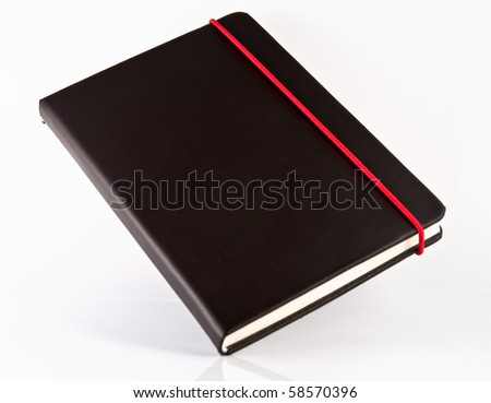 black note book on white isolate,good used for web or background - stock photo