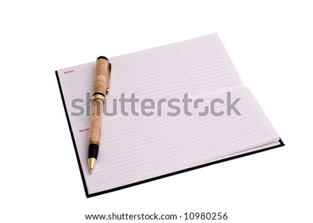 black note book with wooden pen