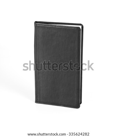 Black notebook in leather cover on white background