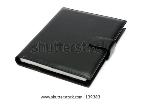 Black notebook on white background - stock photo