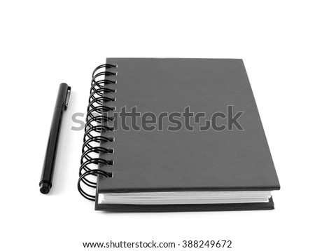 black notebook organizer with pen on white background - stock photo