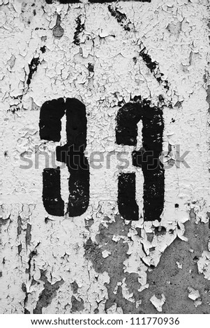 Black number thirty three on a concrete grungy wall painted in white - stock photo