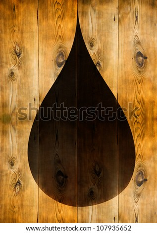 Black oil droplet shape on wooden panels