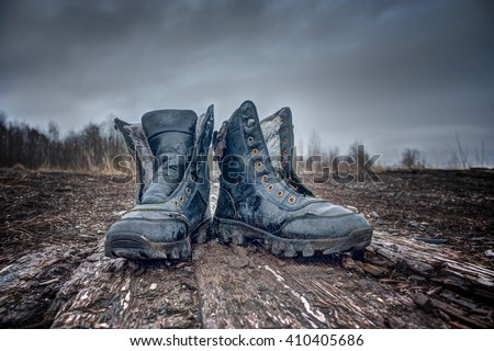 Black old Army Boots. - stock photo
