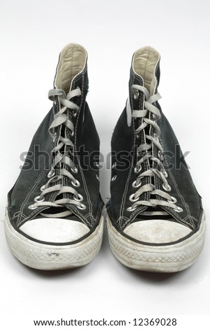 Black old canvas sneakers, isolated - stock photo