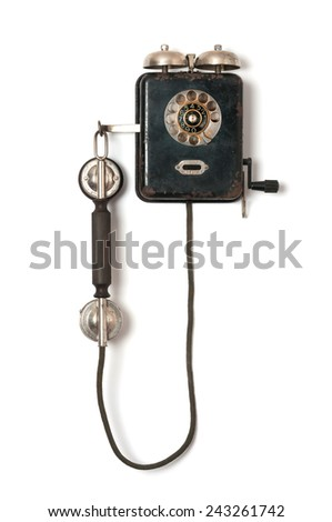 Black old wall telephone on white background - stock photo