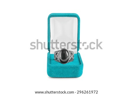 Black onyx ring in blue box isolated over white - stock photo