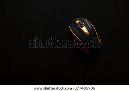 Black-orange mouse on black - stock photo