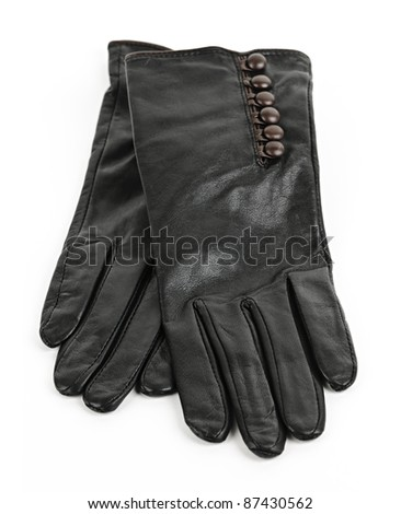 Black pair of leather female gloves isolated on white background