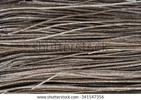 Black pasta dyed with squid sepia ink, Mediterranean staple - stock photo