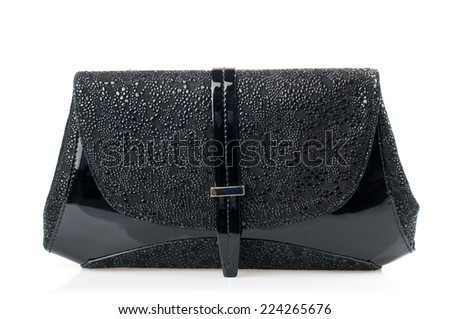 Black patent clutch isolated on white background.  - stock photo
