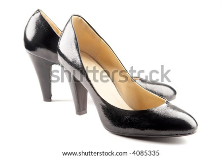 Black patent-leather shoes on white background