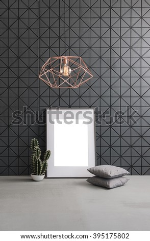 black pattern wall frame concrete floor interior with modern copper lamp - stock photo