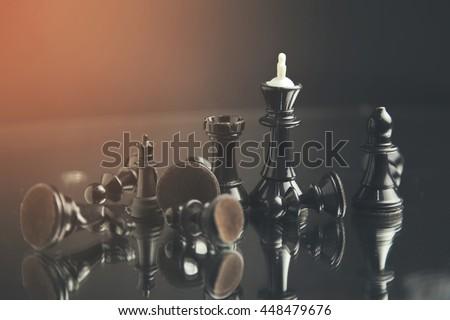black pawn among white chess - stock photo