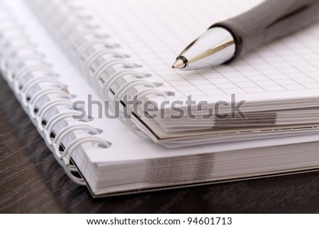 black pen and notebook, closeup - stock photo