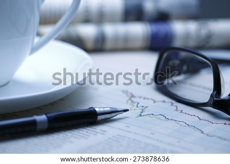 Black pen with financial figures and Glasses,shot with very shallow depth of field. blue tone, - stock photo