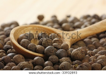 black pepper in wooden spoon - stock photo