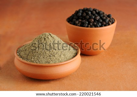 black pepper,milled black pepper,black pepper,heap of powdered black peppe - stock photo