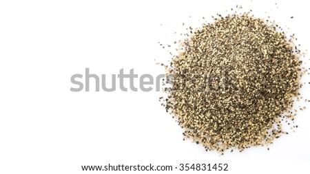 Black pepper powder over white background - stock photo
