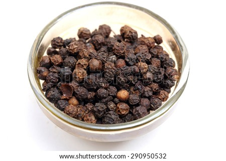 Black pepper seeds in glass bowls. Food and cuisine ingredients