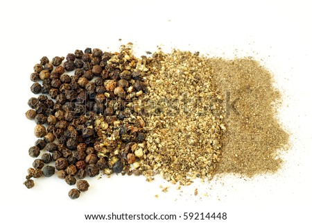 Black pepper - whole, crushed, coarsely and finely ground - stock photo