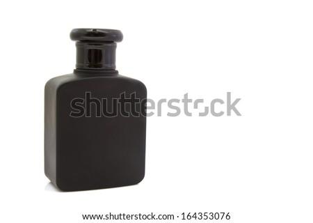 Black perfume bottle on isolated background - stock photo