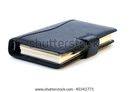 Black personal diary isolated on white