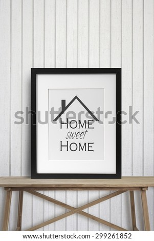 Black picture frame with motivational words on wooden table - stock photo