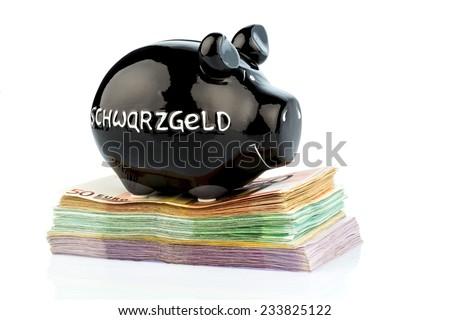 black piggy bank on bank notes, symbolic photo for black money, tax evasion and money laundering - stock photo