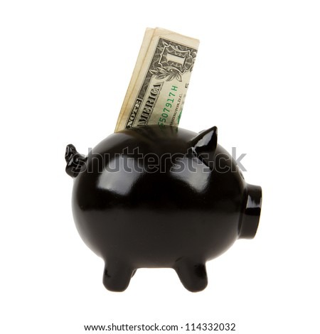 Black piggy bank with one dollar on white background - stock photo