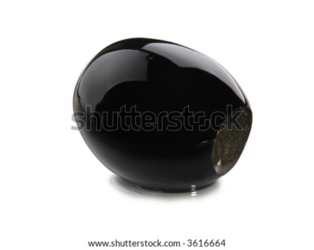 black pitted olive fruit close up on white background - stock photo