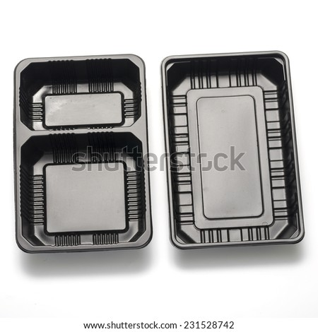 black plastic container on a white background - stock photo