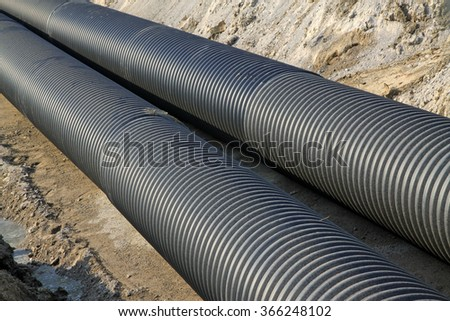 Black plastic pipe, closeup of photo