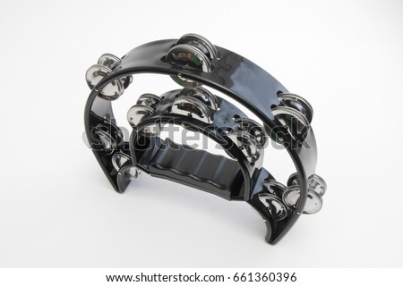 black plastic tambourine on white background